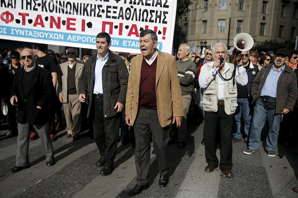 Greek pensioners shout slogans during an anti-austerity demonstration marking a 24-hour strike in Athens, Greece, December 3, 2015