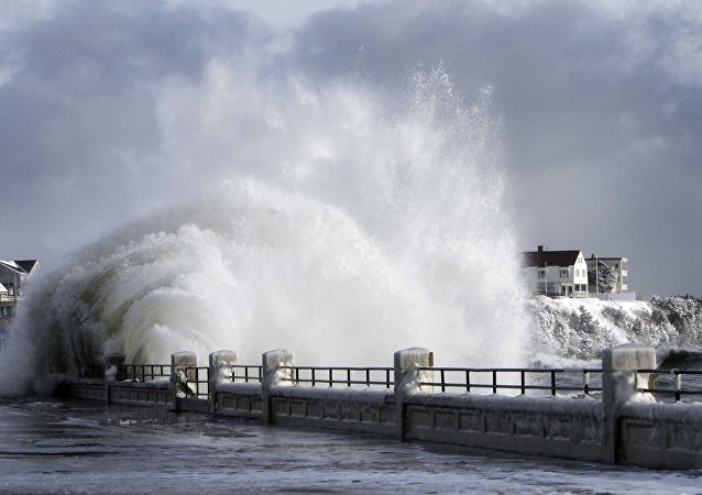 heavy surf breaks over the seawall during a winter storm