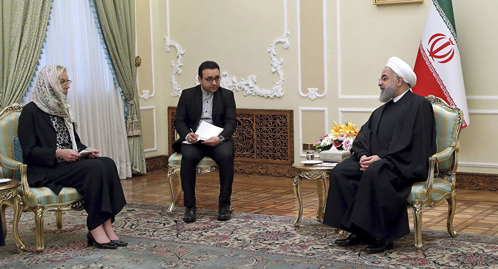 President Hassan Rouhani, right, speaks with the Netherlands' Foreign Minister Sigrid Kaag, left, at the presidency office, in Tehran, Iran