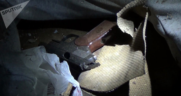 A Makarov gun at the Nizhny Novgorod location where a suspected terrorist who was planning an act of terror on the day of the presidential election was neutralized by the Federal Security Service (FSB) personnel