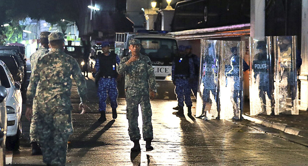 Maldives defence soldiers patrol on the main street of Male, Maldives