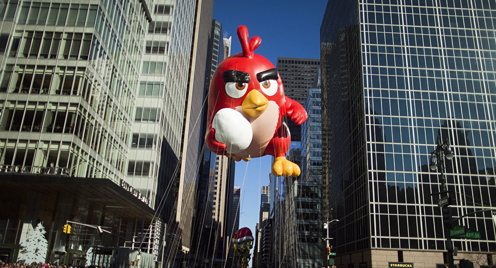 A balloon of Red, from Angry Birds floats down Sixth Avenue during the Macy's Thanksgiving Day Parade in New York, Thursday, Nov. 23, 2017