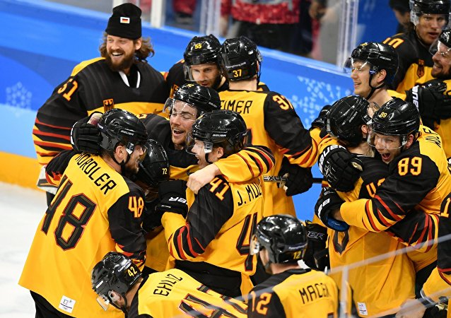 Germany's team members celebrate their victory in the semifinals between the Canada and Germany national teams in the men's ice hockey tournament, at the XXIII Olympic Winter Games
