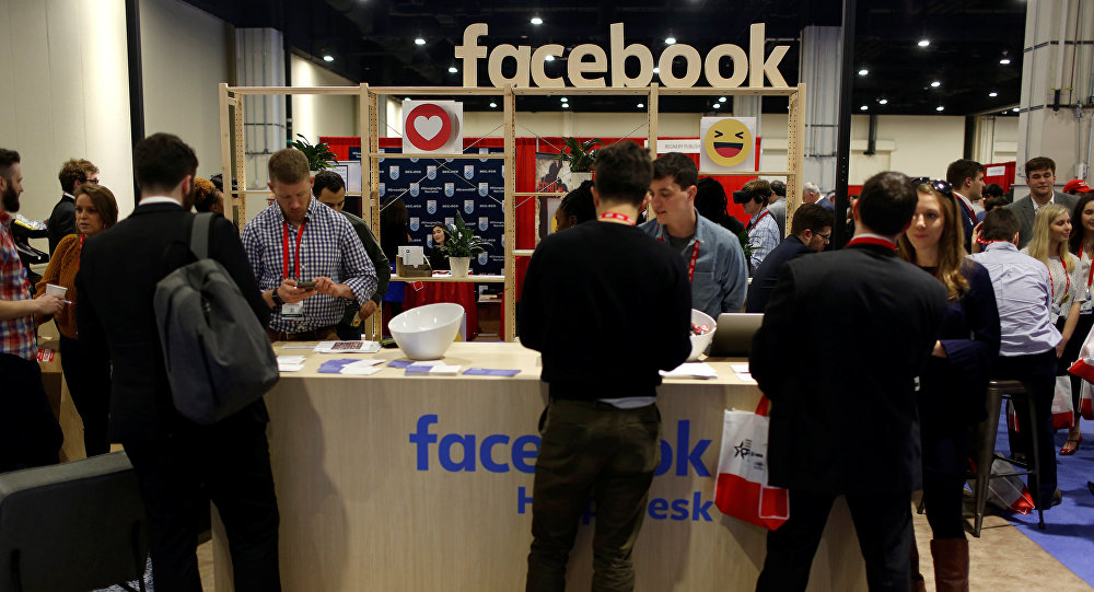 People stop at the Facebook booth at the Conservative Political Action Conference (CPAC) at National Harbor, Maryland, U.S., February 23, 2018