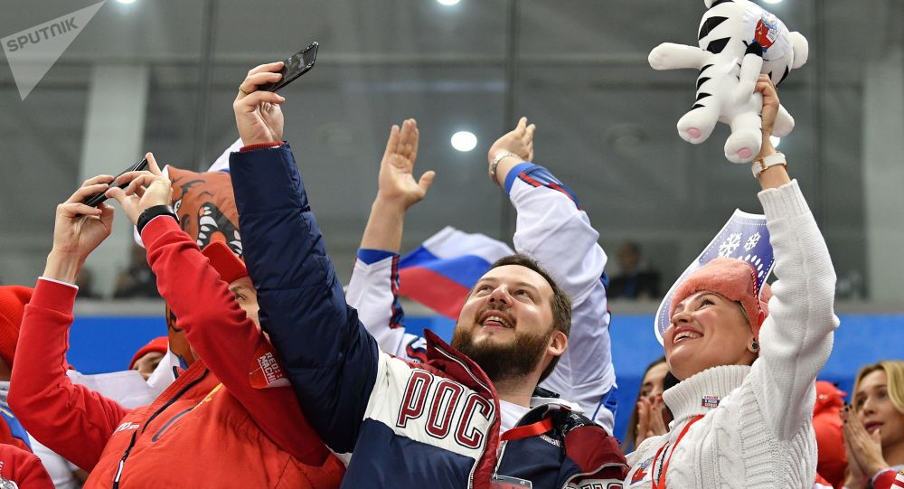 Russian sports fans celebrate a goal during the final match between Russia and Germany in the men's ice hockey tournament at the 2018 Winter Olympics