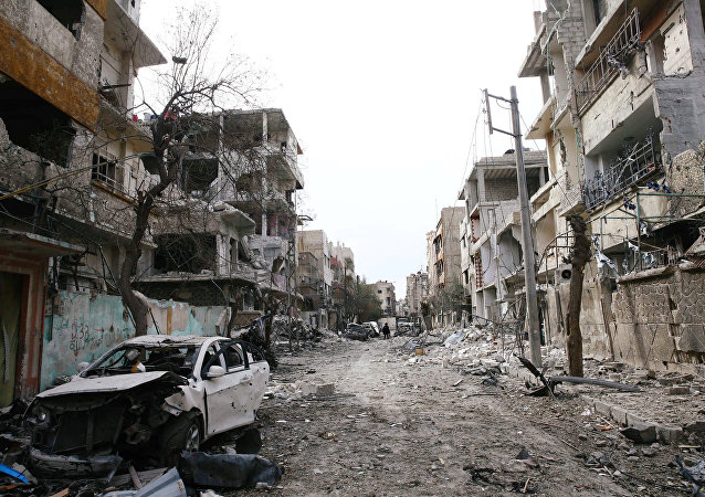 Damaged cars and buildings are seen in the besieged town of Douma, Eastern Ghouta, Damascus, Syria