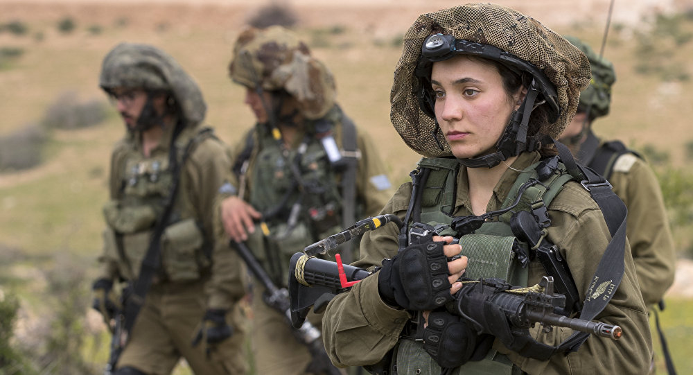 Israeli soldiers from the mixed-gender Lions of the Jordan battalion, under the Kfir Brigade, take part in a last training before being assigned their posting, on February 28, 2017, near the West Bank village of Bardale, east of Jenin