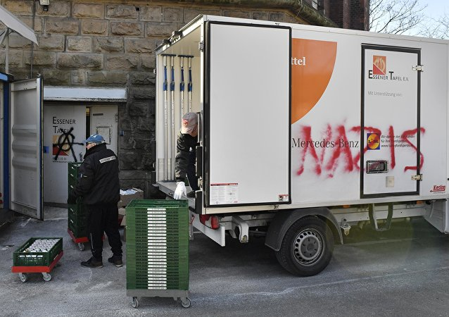 Helpers unload a truck of the food bank Tafel in Essen, western Germany, Tuesday, Feb. 27, 2018