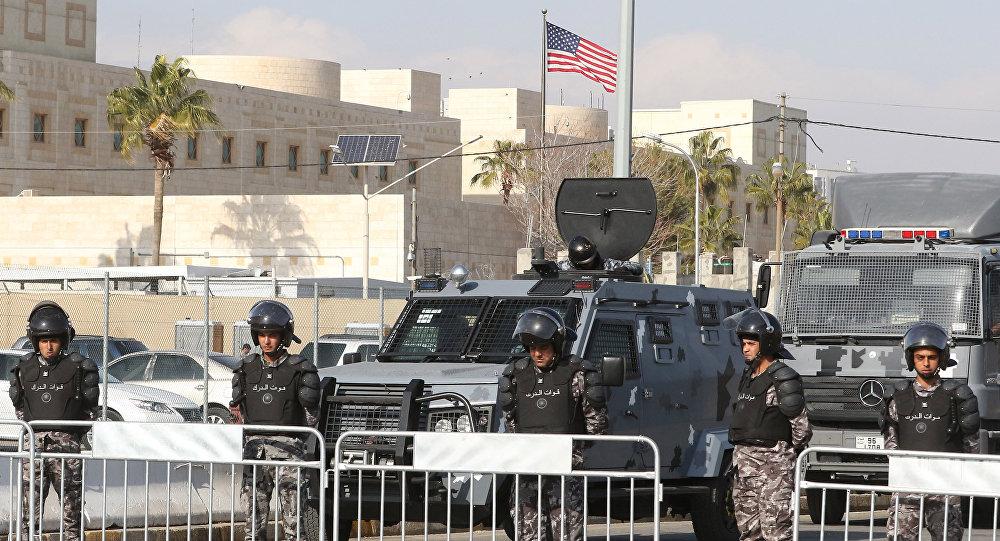 Jordanian security forces stand guard during a demonstration on December 13, 2017 organised by the Muslim Brotherhood and other Islamic movements outside of the American embassy in the capital Amman against the US president's decleration of Jerusalem as the capital of Israel