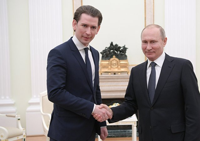 Russian President Vladimir Putin and Chancellor of Austria Sebastian Kurz, left, during a meeting