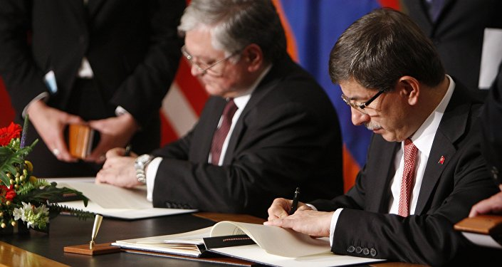 (File) Armenia's Foreign Minister Edouard Nalbandian, left, and Turkey's Foreign Minister Ahmet Davutoglu sign documents during the signing ceremony of a peace accord between Turkey and Armenia in Zurich, Switzerland Saturday Oct. 10, 2009