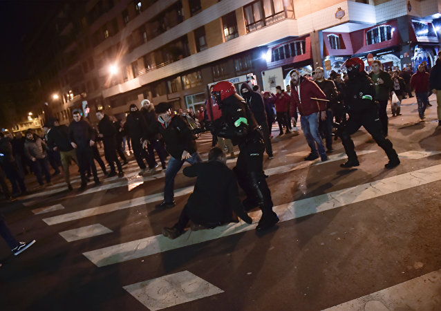 Basque riot police clash with followers of Athletic Bilbao and FC Spartak Moskva before the match during the Europa League - round of 32, 2nd leg, between Athletic Bilbao and FC Spartak Moskva, at San Mames stadium, in Bilbao, northern Spain