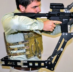 The Third Arm, a prototype mechanical limb designed to carry weapons and armor, courtesy of the US Army Research Lab.