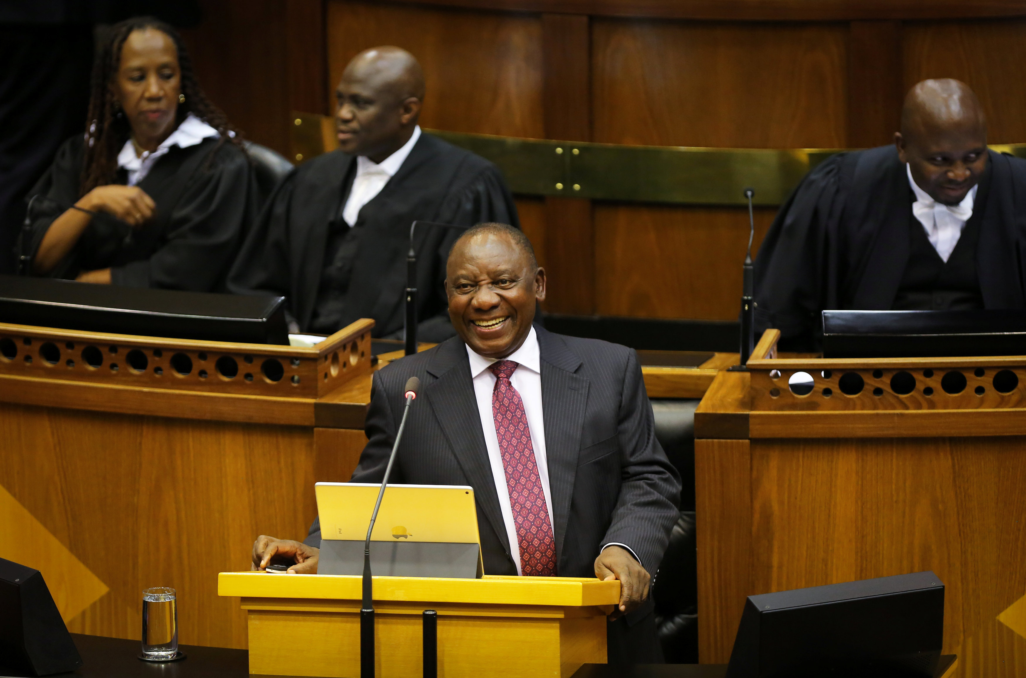 South African President Cyril Ramaphosa speaks in parliament in Cape Town, South Africa February 20, 2018