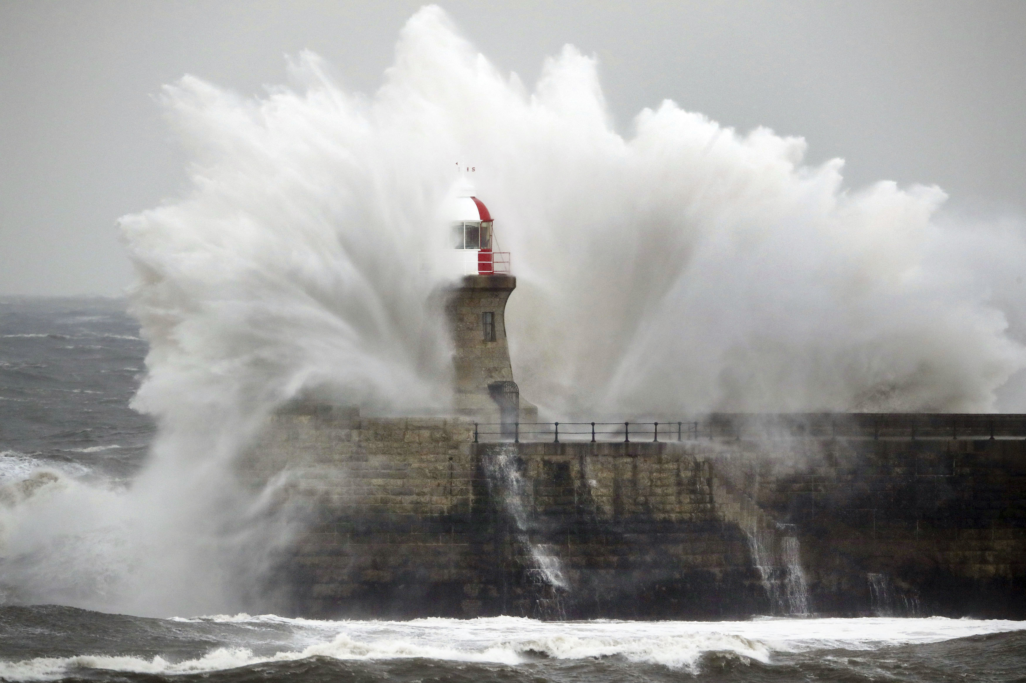 Giant waves crash over Souter Lighthouse in South Shields in Tynemouth, England, Friday, March 2, 2018 as extreme weather has continued to wreak havoc across the UK
