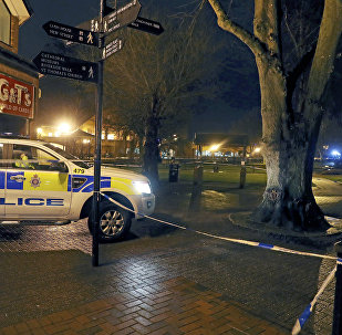 Police cordon off the area near the Maltings in Salisbury, England, where British media reported Monday, March 5, 2018 that a former Russian spy was in critical condition after coming into contact with an unknown substance on Sunday. British media identified him as Sergei Skripal, 66, who was convicted in Russia on charges of spying for Britain and sentenced in 2006 to 13 years in prison. Skripal was freed in 2010 as part of a U.S.-Russian spy swap.