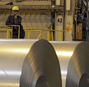 An employee looks on from behind coils of steel as acting Secretary of Labor Seth Harris speaks to workers after a tour of ArcelorMittal Steel's hot dip galvanizing line in Cuyahoga Heights, Ohio (File)