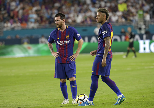 Barcelona's Lionel Messi, left, and Neymar, right, stand on the field during a break in the action during the first half of an International Champions Cup soccer match against Real Madrid, Saturday, July 29, 2017, in Miami Gardens, Fla.