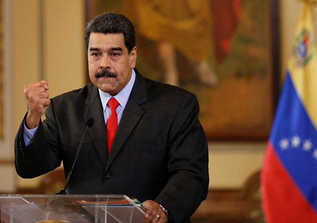 Venezuela's President Nicolas Maduro gestures as he talks to the media during a news conference in Caracas, Venezuela February 15, 2018