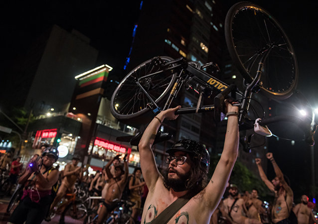 Naked cyclists demonstrate along Paulista Avenue in Sao Paulo, Brazil, to demand better condition of the city roads and to raise awareness on the safety of cyclists and reducing oil dependence, as part of the World Naked Bike Ride (WNBR) international movement, on March 10, 2018