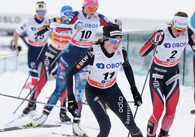 FIS Cross Country World Cup - Women's 30 km Mass Start - Holmenkollen, Norway - March 11, 2018. Nathalie von Siebenthal of Switzerland and Ingvild Flugstad Oestberg of Norway compete
