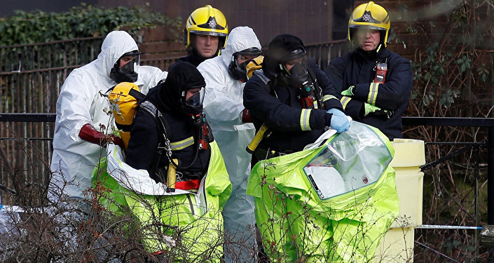 Officials are helped out to take off their protective suits after repositioning the forensic tent, covering the bench where Sergei Skripal and his daughter Yulia were found, in the centre of Salisbury, Britain, March 8, 2018