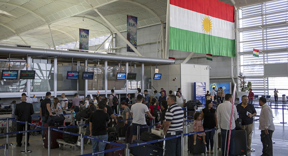Travelers line up to check in at the Irbil International Airport, in Iraq, Wednesday, Sept. 27, 2017