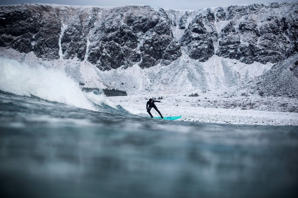 Frosty Shores, Flashy Green Horizons: The Thrill of Winter Surfing