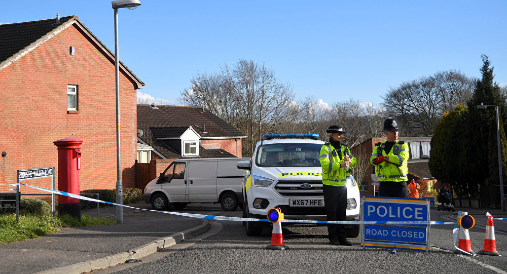 Police officers seal off the road on which Russian Sergei Skripal lives in Salisbury, Britain, March 7, 2018