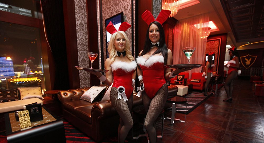 In this photo taken Saturday, Dec. 18, 2010, waitresses pose inside the Playboy Club at the Sands Casino in Macau