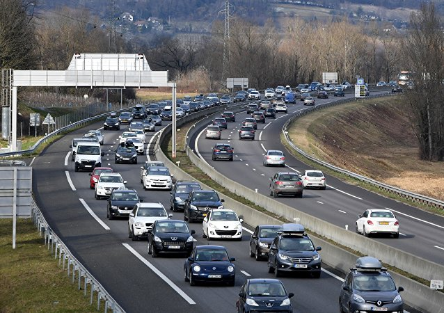 Vehicles run in a heavy traffic on the A43 highway, leading to the French Alps ski resorts on February 10, 2018 in Chignin central eastern France