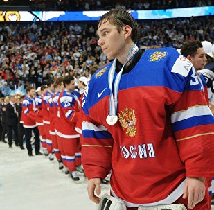 Russia's goalie Alexander Georgiyev with silver medal of the 2016 IIHF Ice Hockey World Junior Championship in Finland
