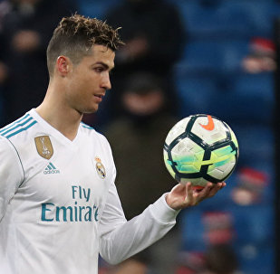 Soccer Football - La Liga Santander - Real Madrid vs Girona - Santiago Bernabeu, Madrid, Spain - March 18, 2018 Real Madrid's Cristiano Ronaldo with the matchball after the match
