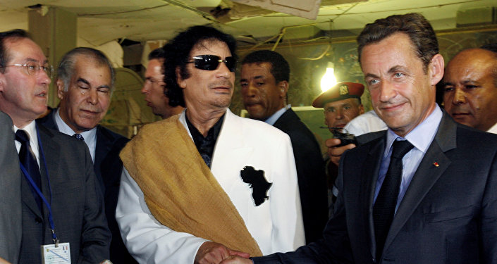 Libya's President Muammar Gaddafi (L) greets his counterpart from France Nicolas Sarkozy at Bab Azizia Palace in Tripoli July 25, 2007, the day after the release of six foreign medics from Libyan jails
