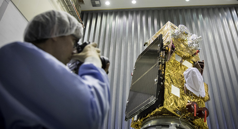 A person takes pictures of the Sentinel-2B satellite of the European Space Agency (ESA) prior to its launch in French Guiana, in Noordwijk, the Netherlands, on November 15, 2016