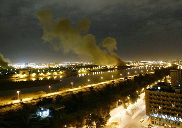In this March 20, 2003 file photo, smoke rises from the Trade Ministry in Baghdad after it was hit by a missile during US-led forces attacks