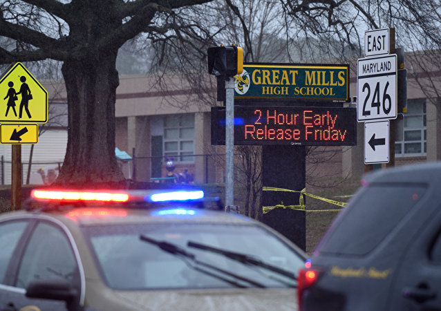 Law enforcement vehicles are seen outside the Great Mills High School following a shooting on Tuesday morning in St. Mary's County, Maryland, U.S., March 20, 2018
