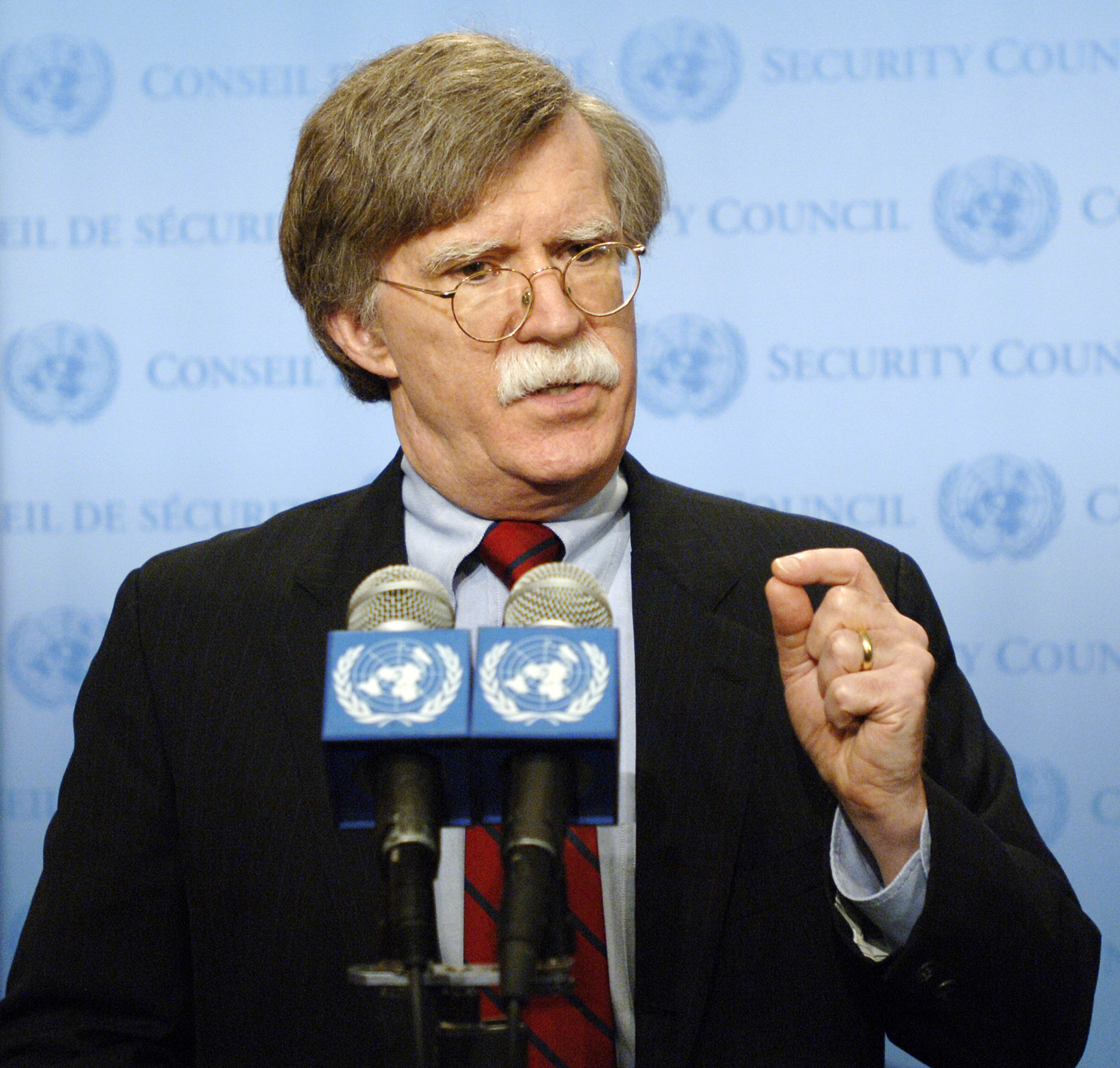John Bolton (R), United States Ambassador to the United Nations, speaks to the media, 09 August, 2006, outside the Security Council at UN headquarters in New York. (File)