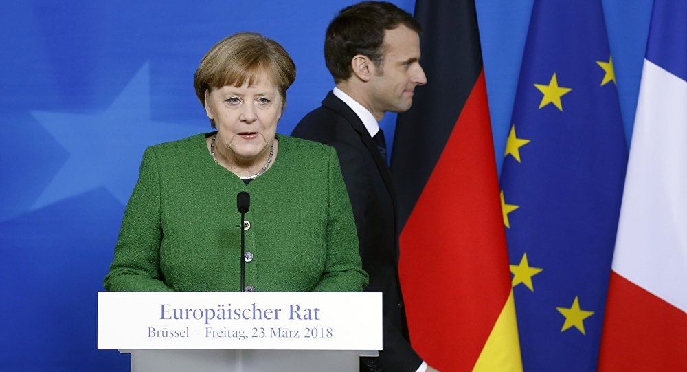 German Chancellor Angela Merkel and France's President Emmanuel Macron hold joint news conference at a European Union leaders summit in Brussels, Belgium