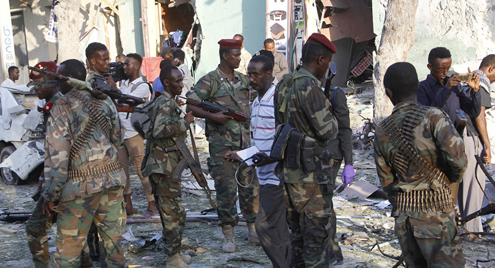 (File) Heavily armed somalis soldiers seal the area after a car bomb exploded in Mogadishu, Somalia Thursday, March 22, 2018