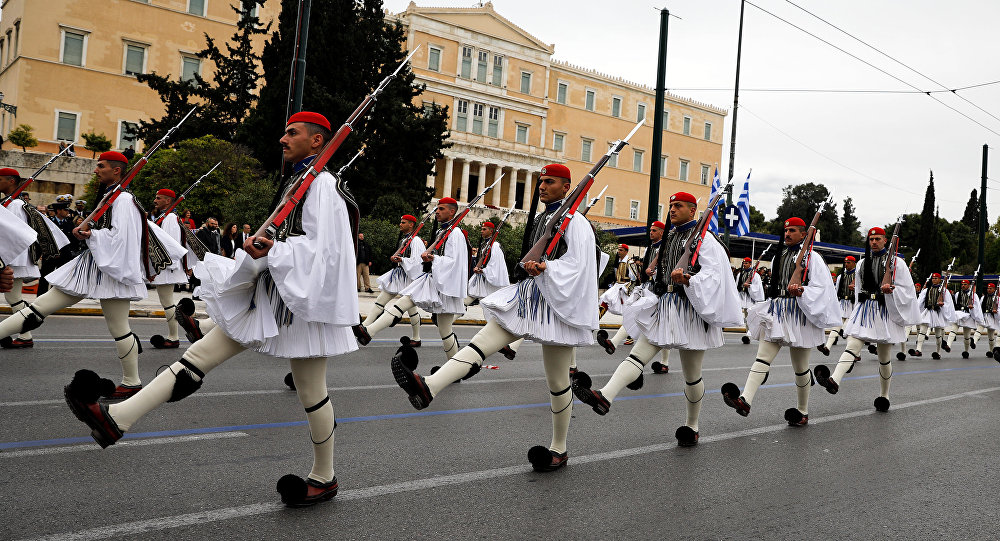 Greek Presidential Guards march during a military parade marking Greece's Independence Day in front of the parliament building in Athens, Greece, March 25, 2018