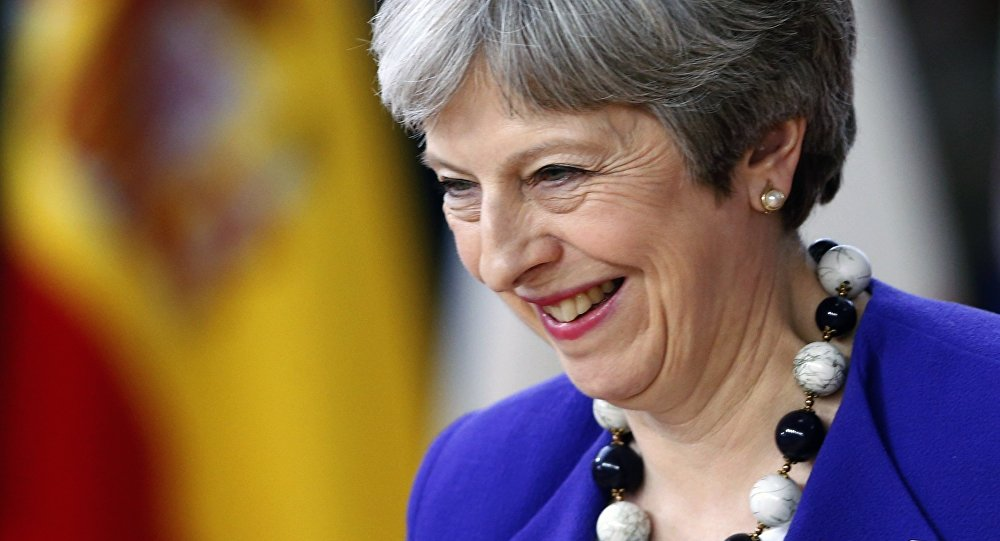 Britain's Prime Minister Theresa May smiles as she arrives at a European Union leaders summit in Brussels, Belgium, March 22, 2018