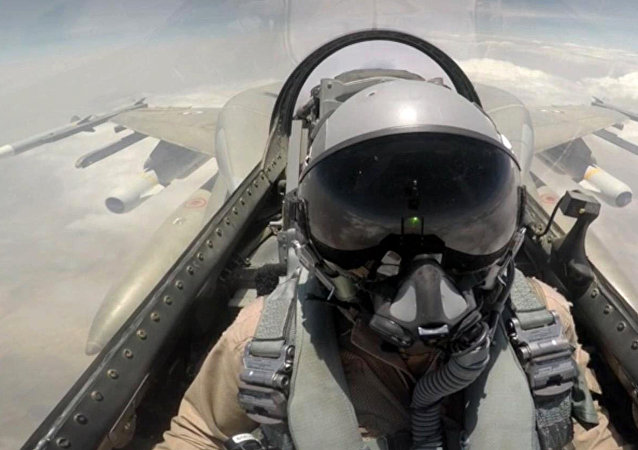 A handout image made available on September 11, 2015 by the United Arab Emirates News Agency (WAM) at taken at an undisclosed location shows a pilot sitting in a cockpit of a fighter jet of the UAE armed forces during raids against Shiite Huthi rebels in Yemen as part of the Saudi-led coalition's Operation Decisive Storm