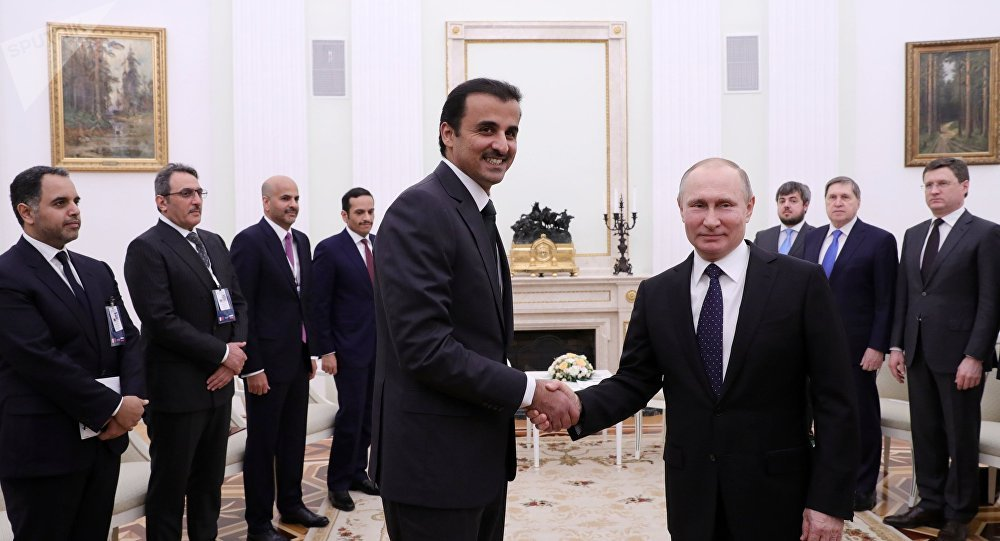 President Vladimir Putin and Sheikh Tamim bin Hamad Al Thani, left foreground, during a meeting