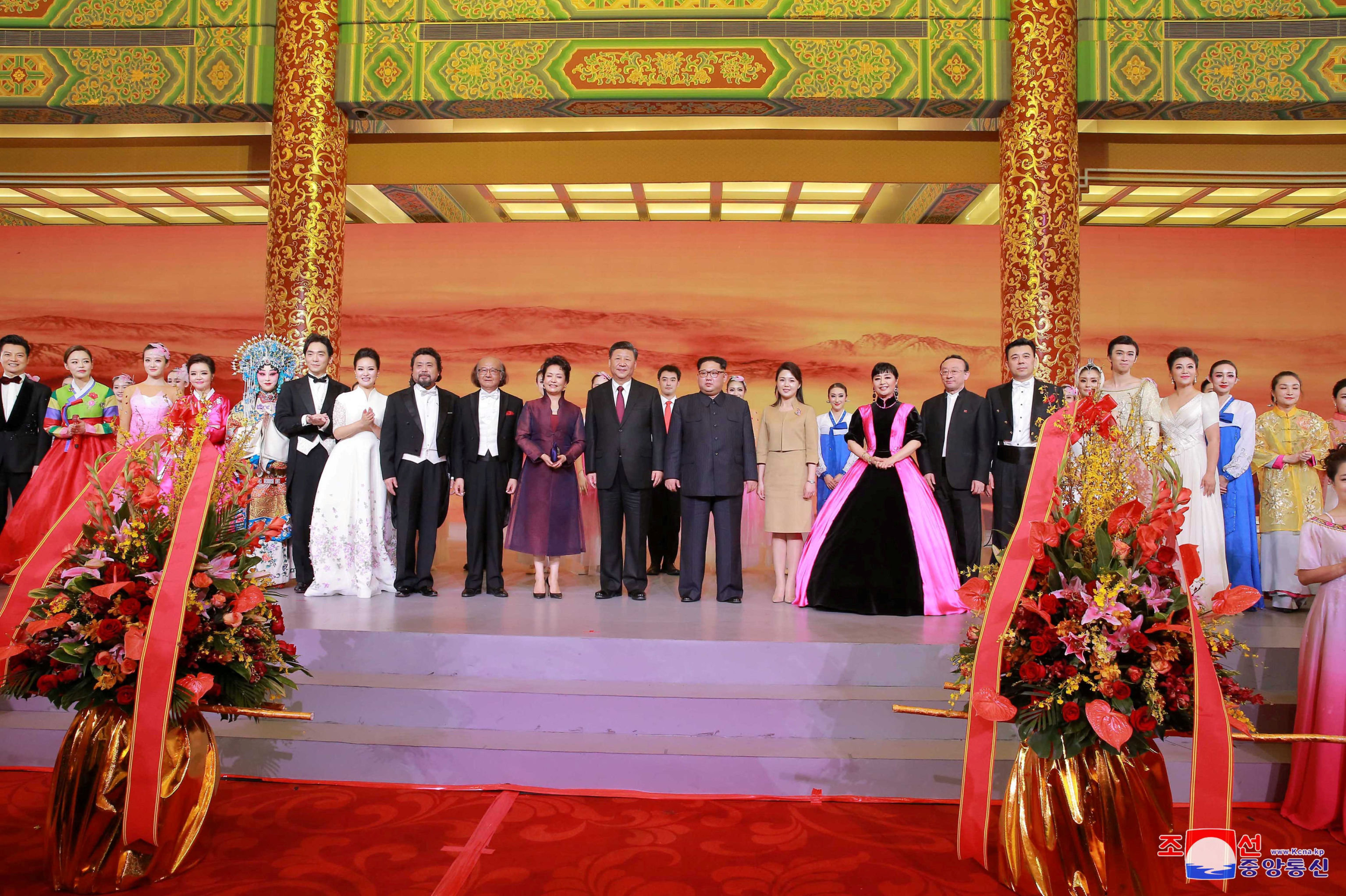 North Korean leader Kim Jong Un and wife Ri Sol Ju, and Chinese President Xi Jinping and wife Peng Liyuan attend a banquet, as Kim Jong Un paid an unofficial visit to Beijing, China