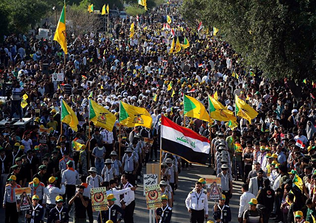 Protesters chant slogans during a demonstration in Baghdad, Iraq