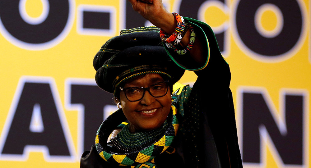 Winnie Madikizela-Mandela, ex-wife of former South African president Nelson Mandela, gestures to supporters at the 54th National Conference of the ruling African National Congress (ANC) at the Nasrec Expo Centre in Johannesburg, South Africa December 16, 2017