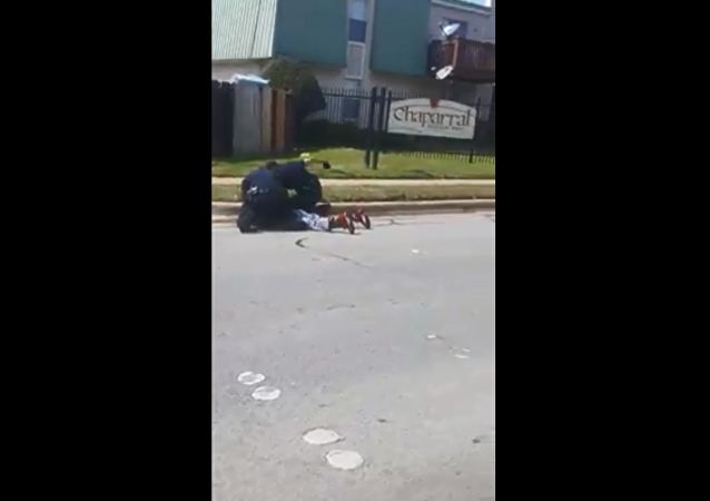 Investigation launched by Fort Worth Police Department after viral videos show two officers punching and kneeing man pinned to the ground