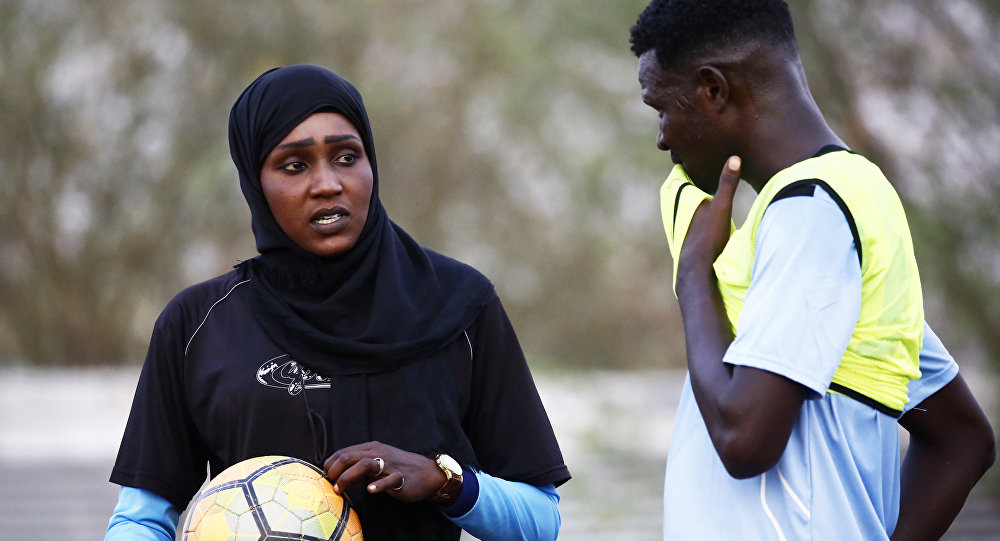 Salma al-Majidi, acknowledged by FIFA as the first Arab and Sudanese woman to coach a men's football team in the Arab world, coaches players of the Al-Ahly Al-Gadaref club during a training session in the town of Gedaref, east of Khartoum on February 17, 2018
