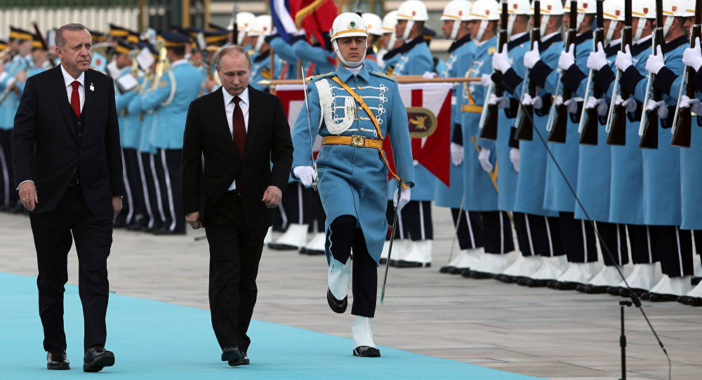 Turkish President Tayyip Erdogan and his Russian counterpart Vladimir Putin review a guard of honour during a welcoming ceremony at the Presidential Palace in Ankara, Turkey April 3, 2018